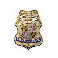 Gold police commissioner badge
